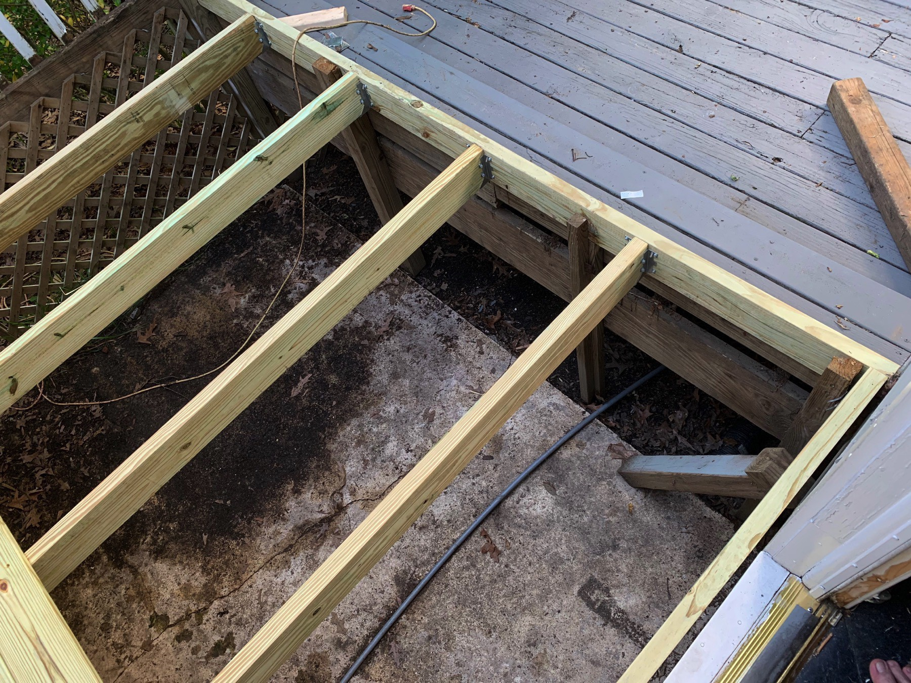 another look from a different angle at the new sleeves, joists, and deck planks we installed